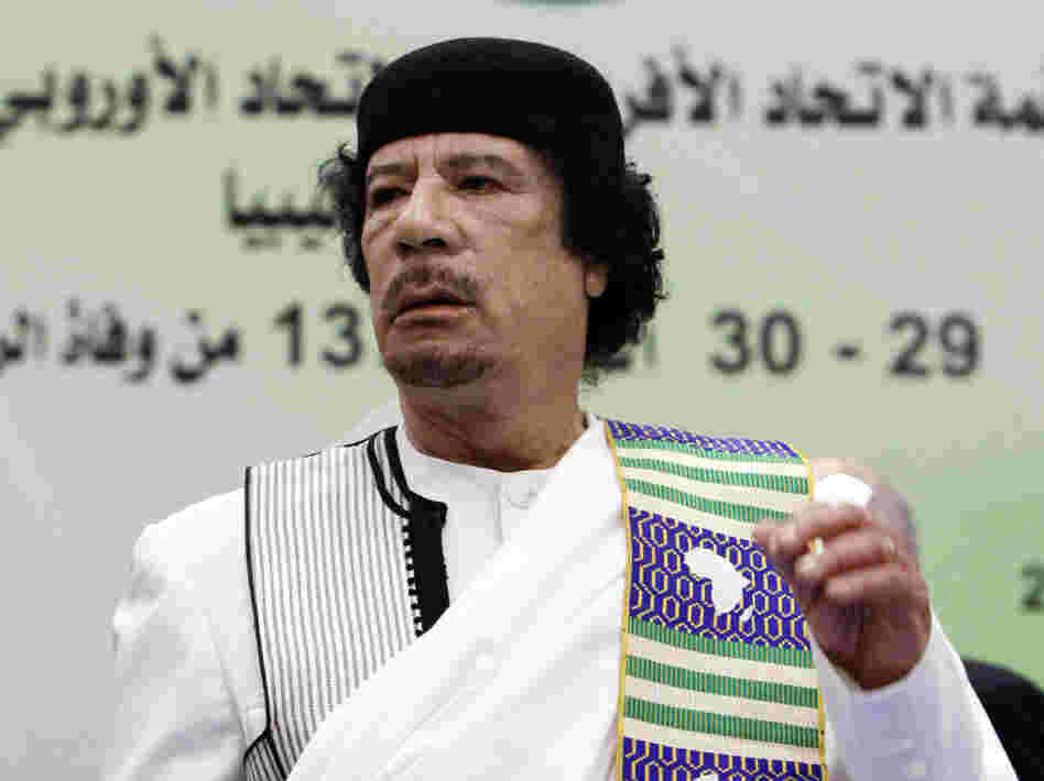Libyan leader Moammar Gadhafi attends the opening session of the Africa-EU summit in November 2010, before the current conflict. Now that the U.S. military has intervened in Libya, many wonder what the endgame is.