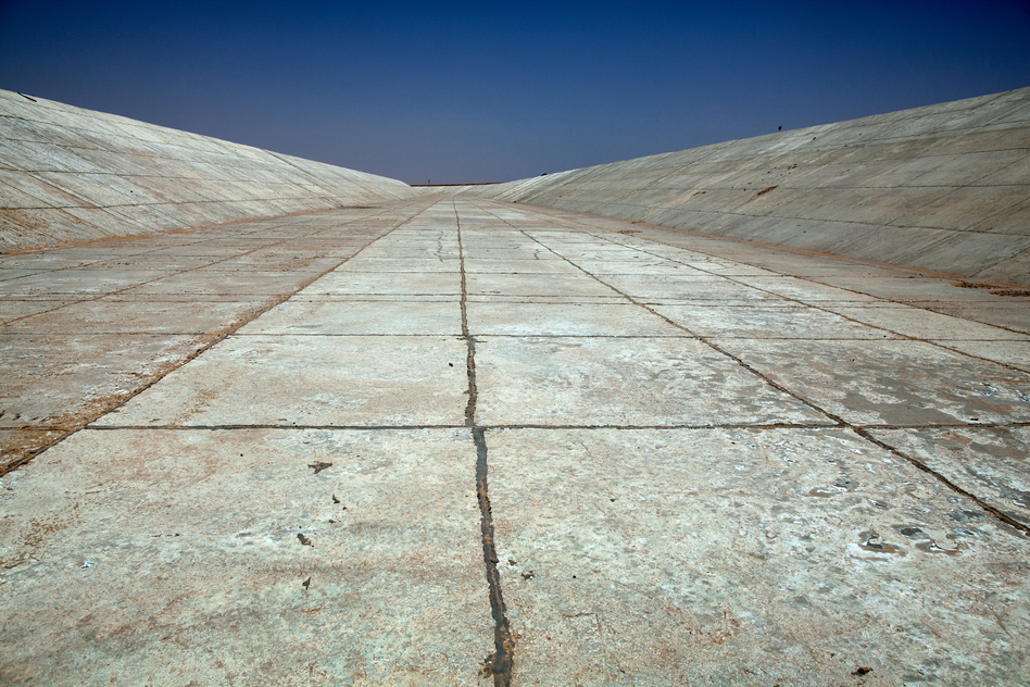 An empty water canal at Sheikh Zayed, near Toshka. Fifteen years after the project's inception, there are just 21,000 hectares of farmland, no schools or hospitals have been built, and the food produced is mainly for export to benefit private landholders. (Redux)