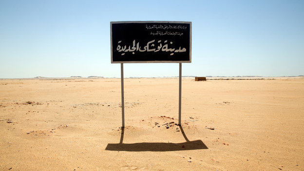 "A sign on undeveloped land welcomes visitors to ""New Toshka City."" Toshka was to be a new settlement along the Upper Nile Valley, complete with enough jobs and infrastructure to support the relocation of 20 million Egyptians from polluted and over-crowded cities. (Redux)"
