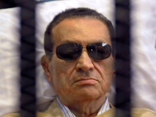 Ousted Egyptian president Hosni Mubarak sits inside a cage in a courtroom during his verdict hearing in Cairo on June 2, 2012. A judge sentenced Mubarak to life in prison after convicting him of involvement in the murder of protesters during the uprising that ousted him last year.