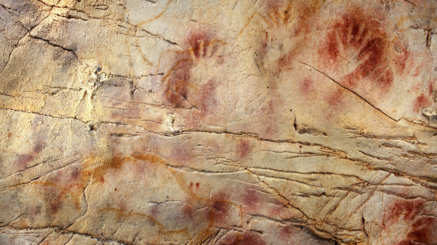 The Panel of Hands in the Cave of El Castillo in Spain. New dating methods suggest the paintings could have been drawn by Neanderthals, not humans, as previously thought. (AAAS/Science)