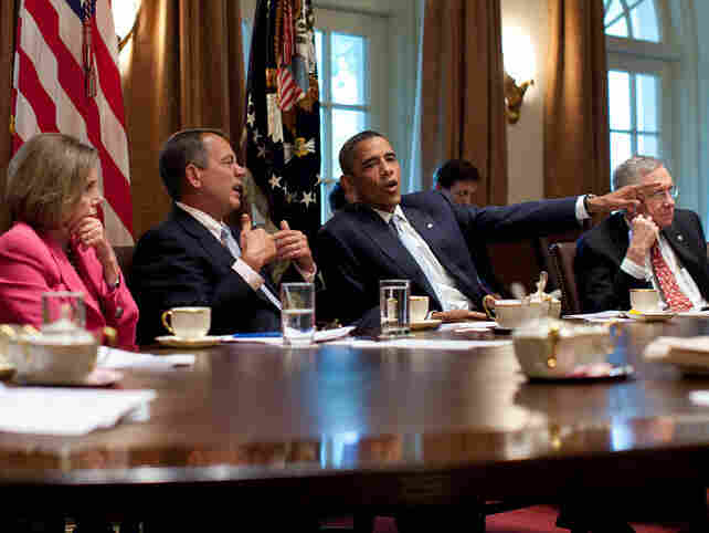 President Obama meets with congressional leaders in the Cabinet Room of the White House to discuss the debt limit and deficit reduction in July 2011.