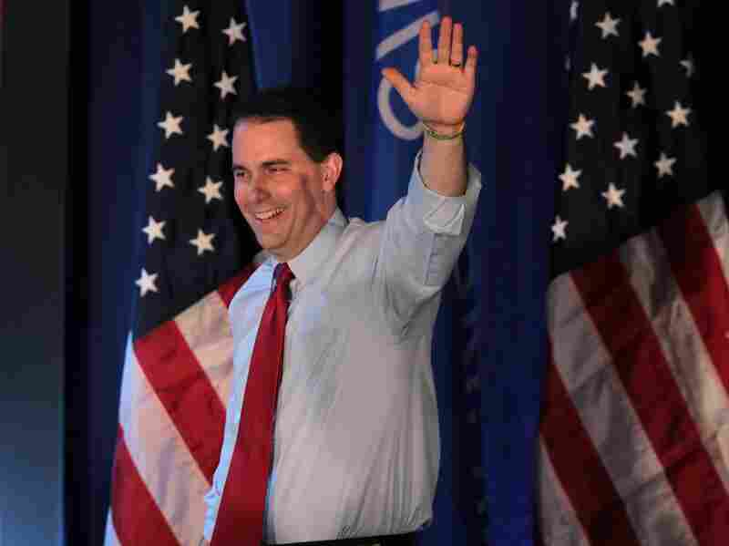 Wisconsin Governor Scott Walker greets supporters at an election-night rally June 5, 2012 in Waukesha, Wisconsin. Walker defeated his Democrat contender Milwaukee Mayor Tom Barrett in a recall that focused on Walker's curtailment of collective bargaining rights for public unions.