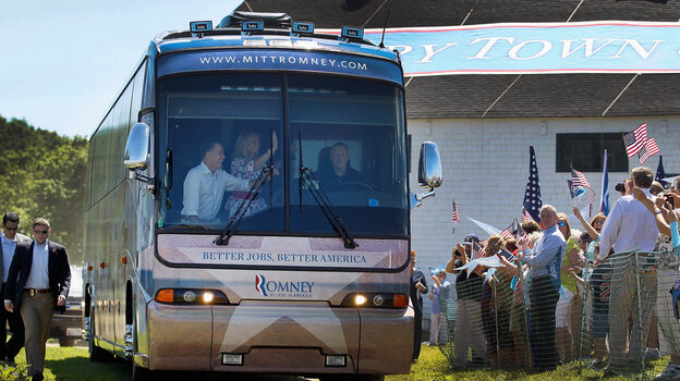 Republican presidential candidate Mitt Romney and his wife, Ann, wave from a campaign bus on Fr