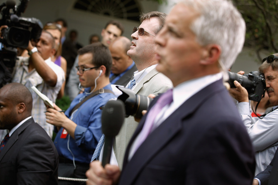 Neil Munro of the Daily Caller (center) interrupts U.S. President Barack Obama with questions as he delivered remarks in the Rose Garden at the White House.