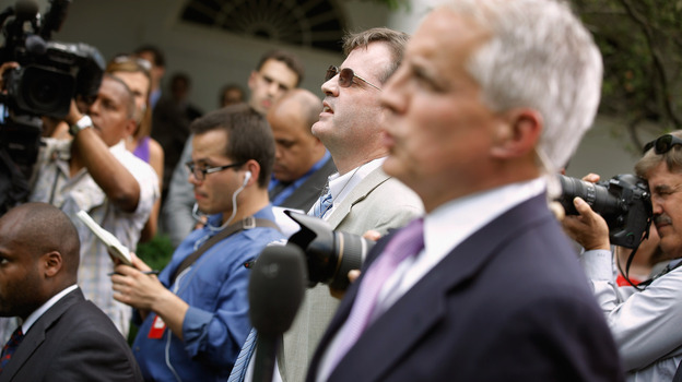 Neil Munro of the Daily Caller (center) interrupts U.S. President Barack Obama with questions as he delivered remarks in the Rose Garden at the White House. (Getty Images)