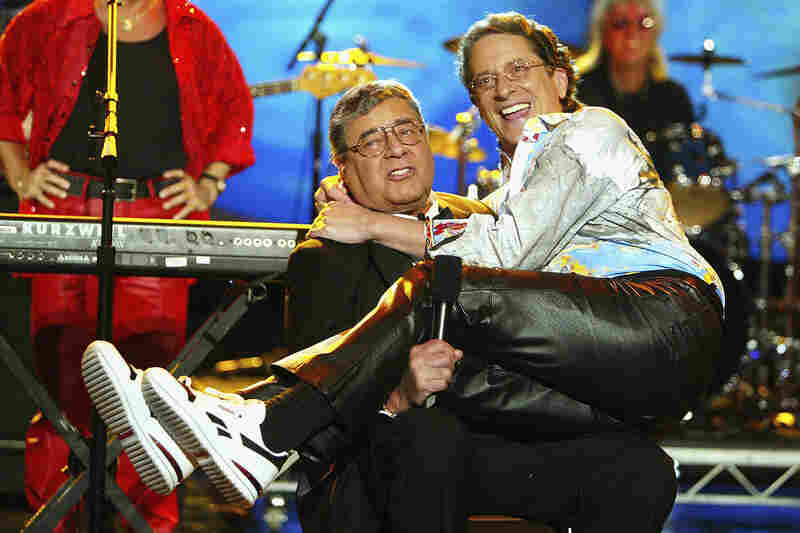Lewis and his son, singer Gary Lewis, joke around at a telethon in 2004.