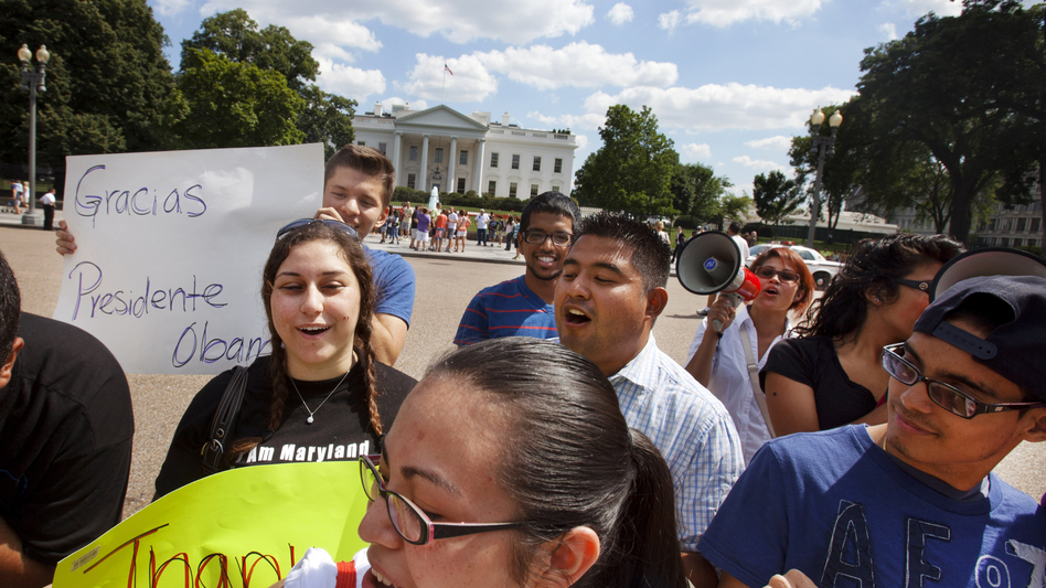 Supporters of President Obama's announcement on immigration policy rally outside the White House Friday. (AP)