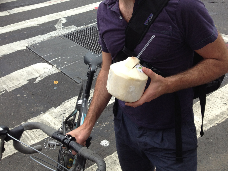 John Gordon Gauld, a 35-year old artist, bikes with coconut water in New York City. (Jacob Anderson)