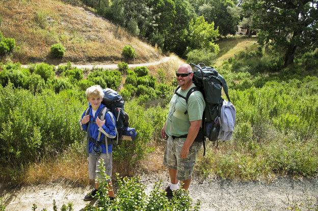 Brad Beadell (right) takes his 11-year-old son, William, on his first backpacking trip through Henry W. Coe State Park in Morgan Hill, Calif