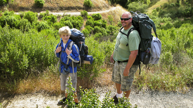 Brad Beadell (right) takes his 11-year-old son, William, on his first backpacking trip through Henry W. Coe State Park in Morgan Hill, Calif. (NPR)