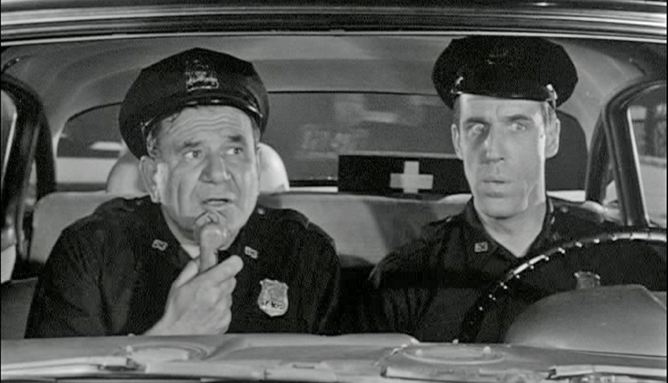 NYPD officers Gunther Toody (Joe E. Ross) and Francis Muldoon (Fred Gwynne) patrolled the Bronx in the 1960s sitcom<em> <em>Car 54, Where Are You?</em> </em>
