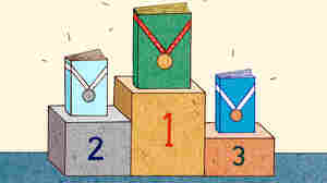 Three books with medals stand on a podium.