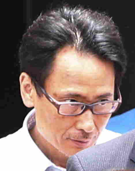 Katsuya Takahashi, the last fugitive connected to the 1995 sarin attack on Tokyo's subway system, after his arrest today.