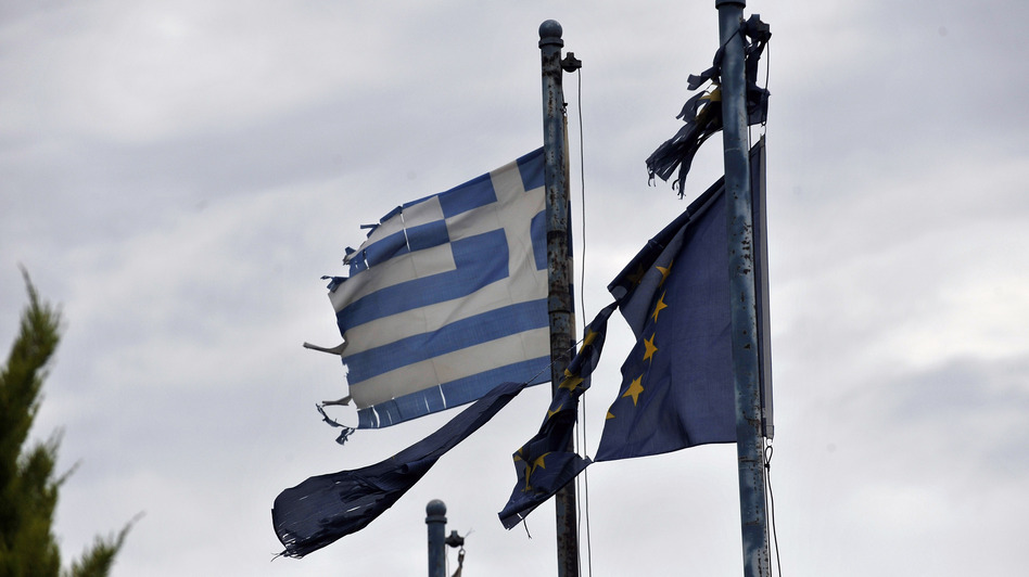 Torn Greek (left) and European Union flags fly at the entrance of an abandoned factory in the industrial zone of Komotini about 500 miles from Athens. Sunday's parliamentary election will go a long way toward determining whether Greece stays in the EU. (AP)