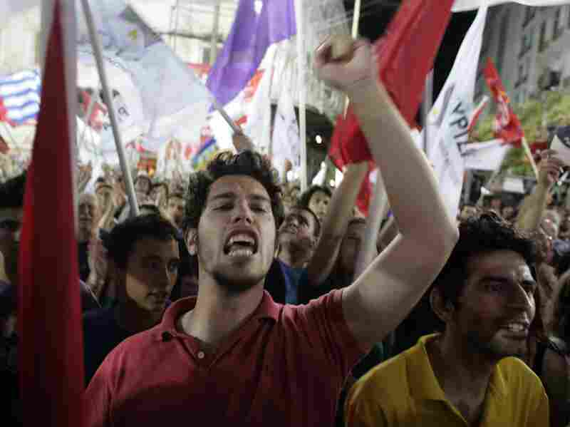 Young supporters react as they attend a Syriza Party pre-election rally on June 14 in Athens, Greece. The Greek electorate are due to go to the polls on June 17 in a re-run of the general election after no combination of political parties were able to form a coalition government.