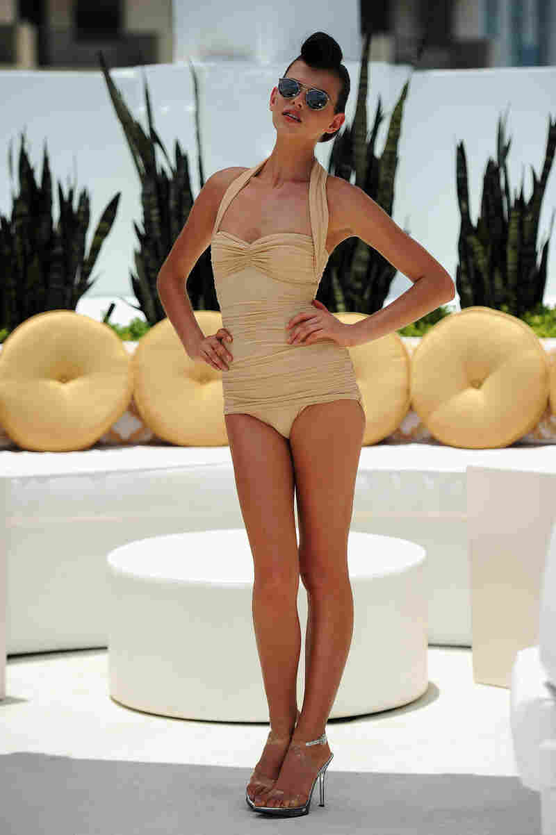 High-end designer Norma Kamali presented swimwear such as the one-piece being modeled here at Mercedes-Benz Fashion Week Swim 2012 in Miami.