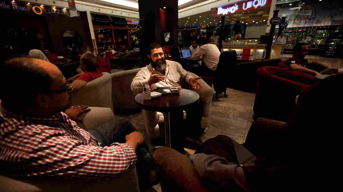 Mohammed Tolba (center) talks with friends at a coffee shop in the Cairo suburbs. The 33-year-old Egyptian is trying to change the public perception of Salafists, Muslims who believe in a literal interpretation of the Quran.