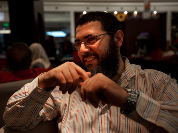 Tolba sports a bushy beard — a marker of religious conservatives — yet also wears Western-style jeans. He says he doesn't agree with all aspects of modern life in Egypt, yet he knows he cannot change things overnight.