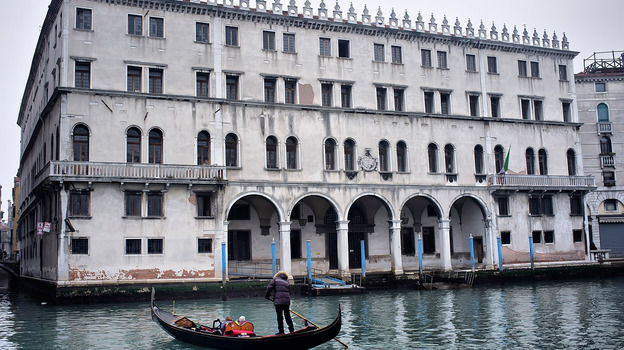 A gondola sails in front of the Fondaco dei Tedeschi, which has been sold to Benetton Group. The clothing company plans to convert the Venice landmark into a shopping mall. (Getty Images)