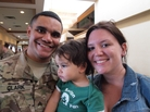 Sgt. Michael Clark and his fiancee, Kaitlin Forant, hold their son, Michael Clark Jr. It took time for the 18-month-old to recognize his father after Clark's deployment.