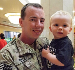 Spc. Bryan Tolley and his 18-month-old son, Ryan. While deployed, Tolley would see children that would remind him of Ryan and immediately call home.