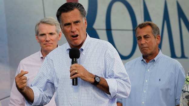 Republican presidential candidate Mitt Romney campaigns with Sen. Rob Portman of Ohio (left) and House Speaker John Boehner on Sunday in Troy, Ohio. (Getty Images)