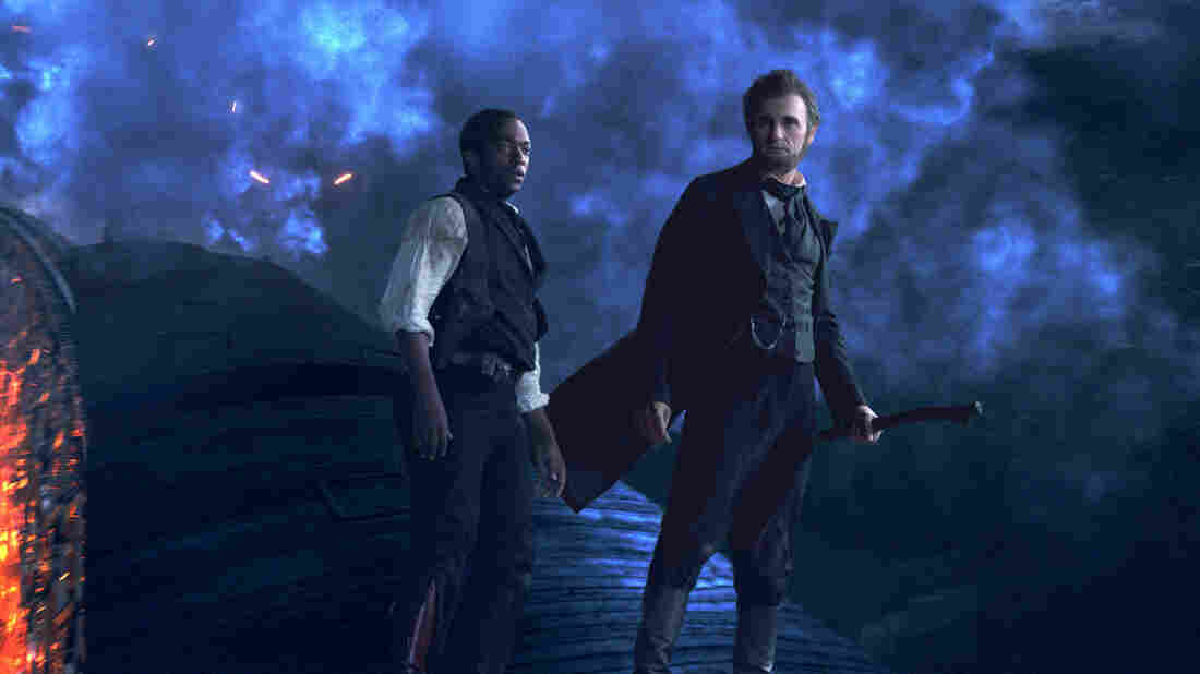 Abraham Lincoln (Benjamin Walker) and Will Johnson (Anthony Mackie) in one of the slick action sequences from Abraham Lincoln: Vampire Hunter. Lincoln's weapon of choice in the film is a silver-plated ax.