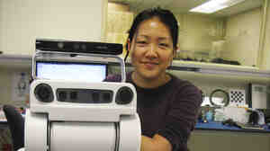 Research scientist Leila Takayama poses with a PR2 robot at Willow Garage, a robotics company in Menlo Park, Calif., that produces programmable robots.