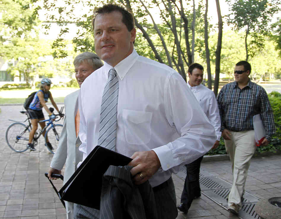 Former Major League Baseball pitcher Roger Clemens, accompanied by his attorney Rusty Hardin, left, arrives at federal court in Washington on June 11.