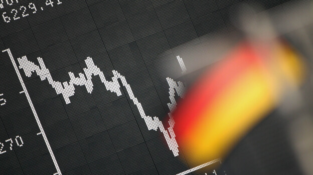 Frankfurt: A German flag hung today in front of a board displaying the DAX stock index. (AFP/Getty Images)