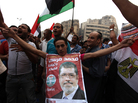 Supporters of Muslim Brotherhood candidate Mohammed Mursi (in portrait) celebrated today in Cairo's Tahrir Square.