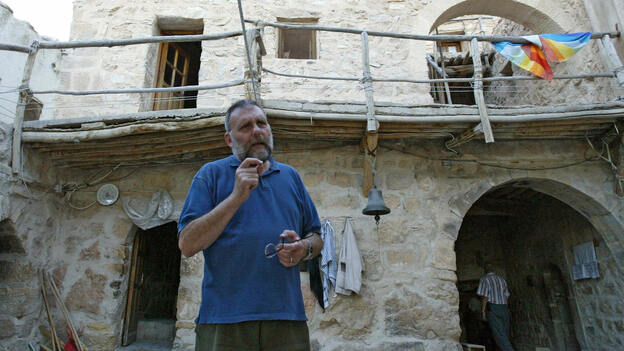 The Italian Jesuit priest Paolo Dall'Oglio, shown here at the Syrian Maronite monastery of Deir Mar Musa in 2007, lived in Syria for 30 years before he was expelled Saturday. Dall'Oglio has spoken out in support of protesters who oppose President Bashar Assad. (AFP/Getty Images)