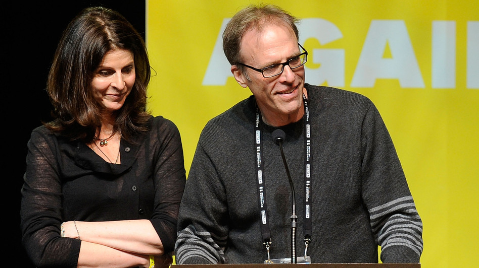 Producer Amy Ziering and Director Kirby Dick accept an award at this year's Sundance Film Festival for their documentary The Invisible War, which looks at sex crimes in the military. (Getty Images)