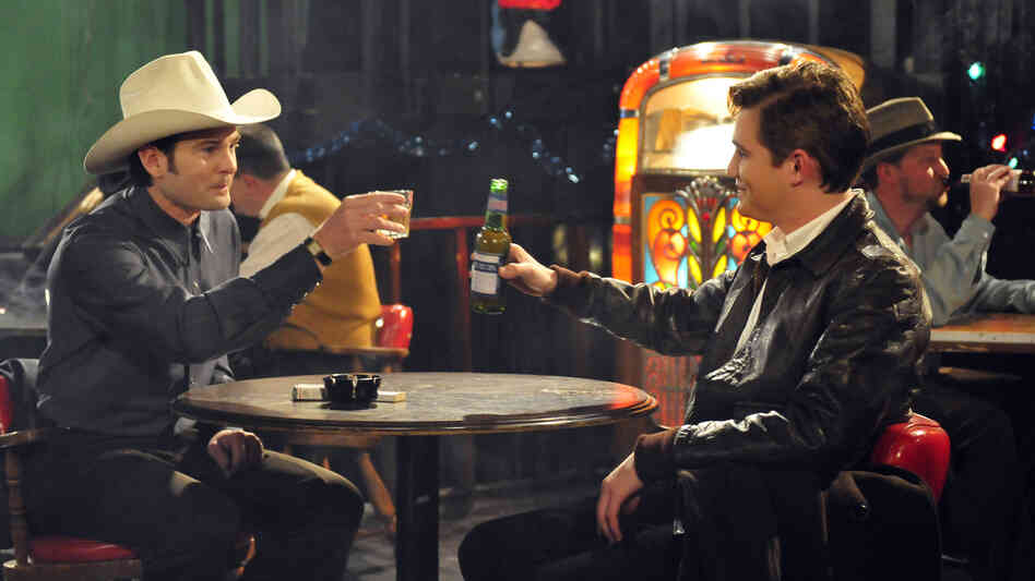 In The Last Ride, Silas (Jesse James, right) is hired to drive Hank Williams (Henry Thomas) to his New Year's gigs and must learn to stand up to the country singer's hectoring behavior.