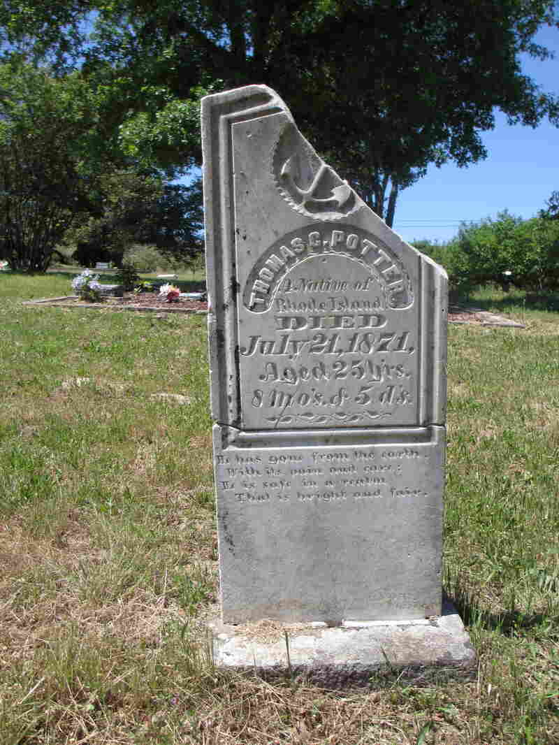"""The partially restored headstone for Thomas C. Potter, who traveled west from Rhode Island, shows that he died on July 21, 1871, at age 25. The inscription reads, """"He has gone from the earth, With its pain and care: He is safe in a realm That is bright and fair."""""""