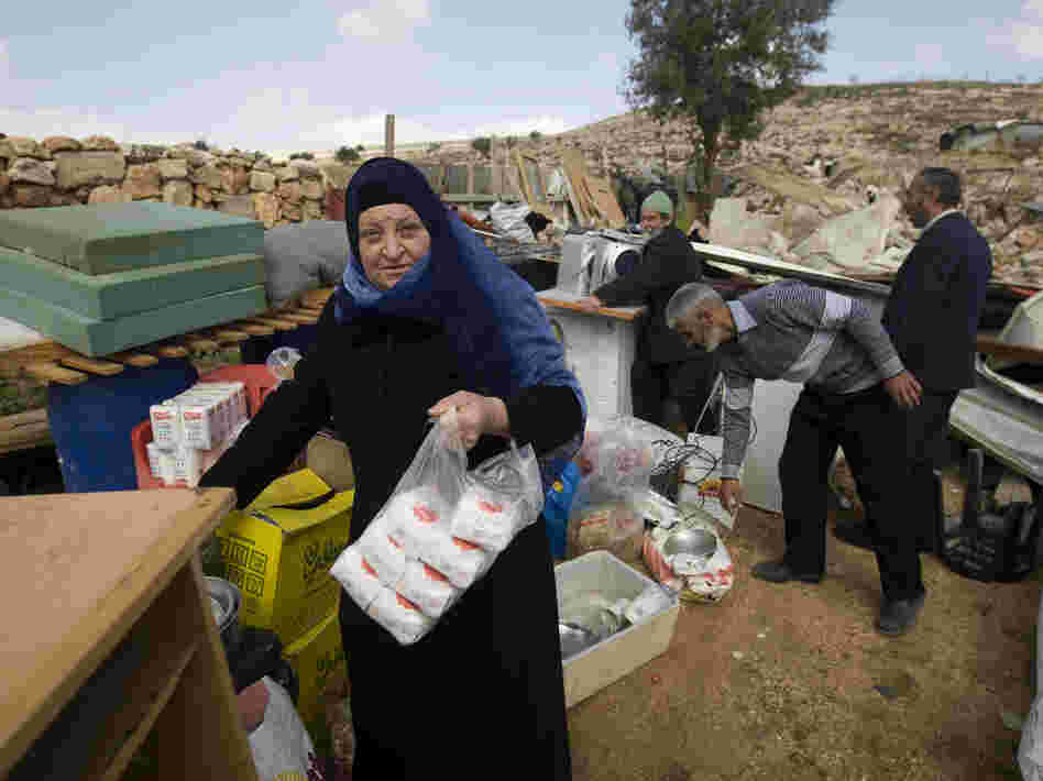 Palestinians collect their belongings after Israeli bulldozers raze their house in an Arab neighborhood in east Jerusalem on Feb. 9.