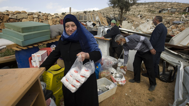 Palestinians collect their belongings after Israeli bulldozers raze their house in an Arab neighborhood in east Jerusalem on Feb. 9. (AFP/Getty Images)