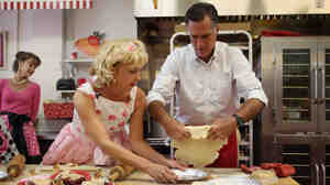 Republican presidential candidate Mitt Romney makes a pie shell with store owner Linda Hundt during a campaign stop Tuesday in DeWitt, Mich.