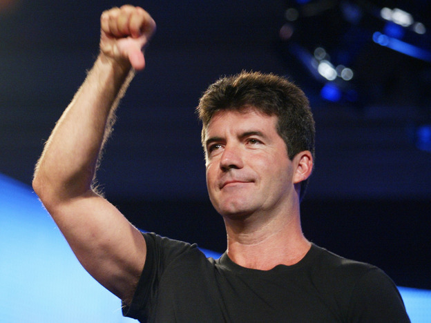 Simon Cowell in his early days as an <em>American Idol </em>judge. The success of Cowell and others shows that bullying is acceptable, says Eric Deggans, so long as it's done on reality TV.