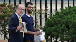 Dharun Ravi, 20, as he walked way from the Middlesex (N.J.) County jail with his attorney Steven Altman, left, earlier today.