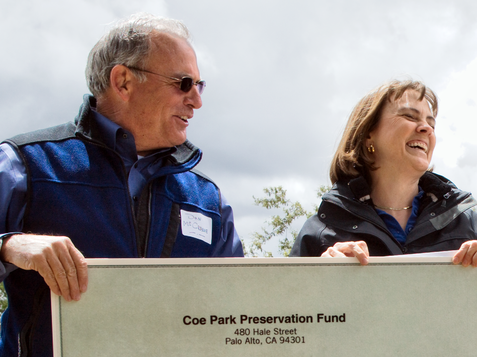 Dan McCranie (left) hands over a check for $279,000 to Ruth Coleman, director of California State Parks, at a ceremony at Coe Park in May. The amount is the first installment of about $900,000 from the Coe Park Preservation Fund that will keep the park open for three years. (Courtesy of Coe Park Preservation Fund)