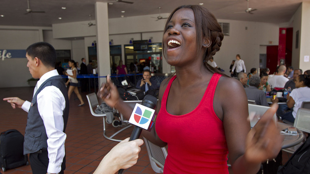 Niouseline St. Jean, originally from Turks and Caicos Islands who lives in the U.S. illegally, reacts as she talks to the media about the new immigration ruling for students at the Miami Dade Community College in Miami last Friday. (AP)