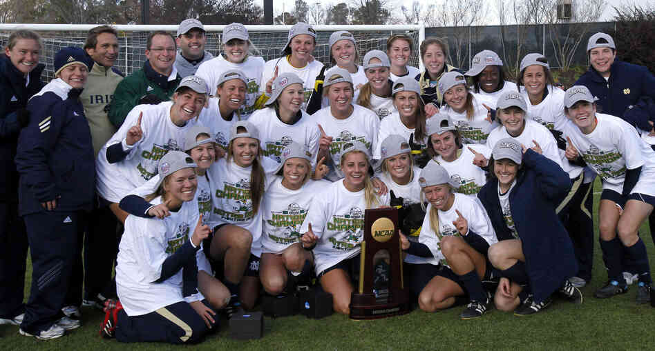 The adoption of Title IX has spurred growth in women's collegiate sports, including soccer. But a women's pro league has struggled, cutting its season short this year. Here, Notre Dame celebrates winning the NCAA College Cup in 2010.