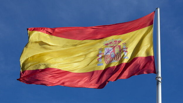 The Spanish flag blowing in the wind in Madrid earlier this month