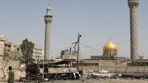 A suicide car bombing destroyed this bus outside a Shiite holy shrine in a Damascus, Syria, suburb on June 14. More than a dozen people were hurt in this attack as the violence nationwide continues to escalate.