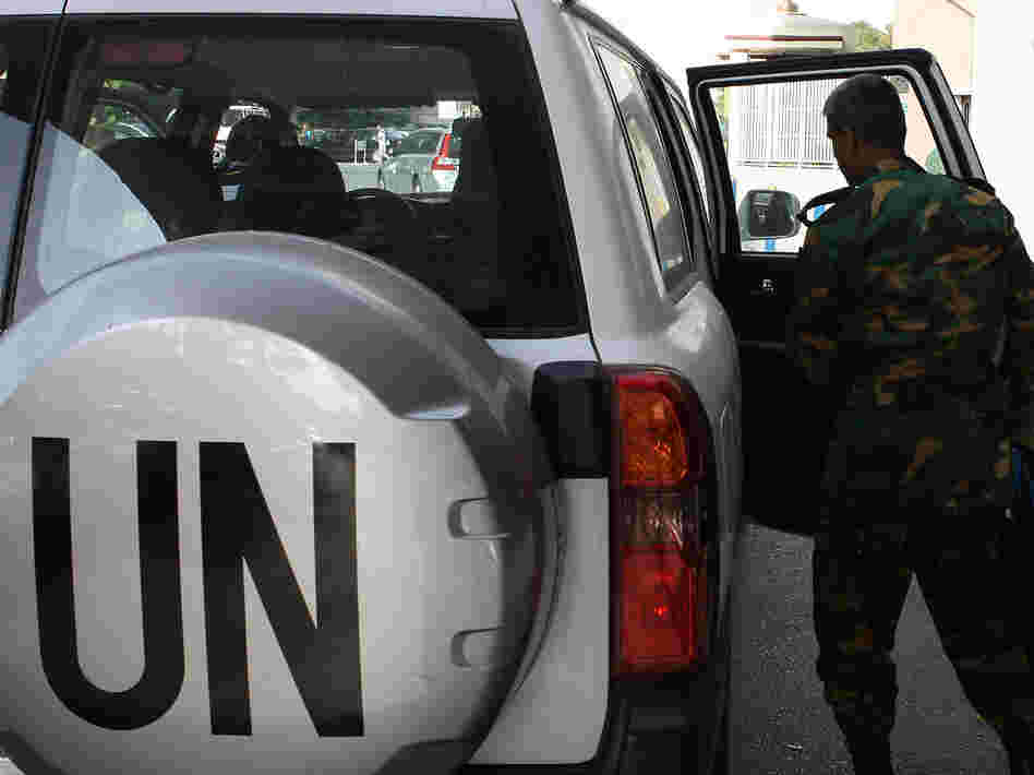 The United Nations observer team in Syria suspended its mission last Saturday, June 16, after facing repeated dangers and difficulties in trying to do its work. One observer is shown here next to a U.N. vehicle outside a hotel in Damascus.