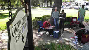 Daily auctions are held on foreclosed properties in front of the county courthouse in Corona, Calif. About 80 bidders, representing investors, show up to bid on properties.