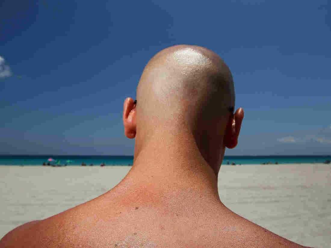Stefano Amabili walks under the sun on the beach on May 10, 2012 in Miami Beach, Florida.