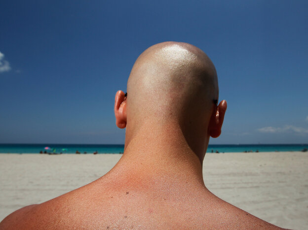 Stefano Amabili walks under the sun on the beach on May 10, 2012 in Miami Beach, Florida.